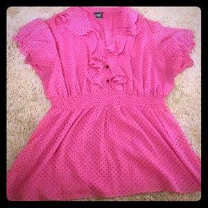 Pink shirt with black polka dots
